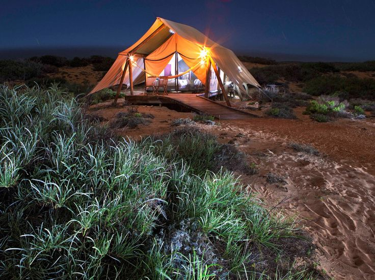 The only wealth on display around this huddle of nine khaki tents on the western Australian coast is the natural riches of Cape Range National Park and the Ningaloo Reef. This eco-rigorous camp's small size and green protocols (solar power, composting toilets, easily dismantled pole-mounted dwellings)