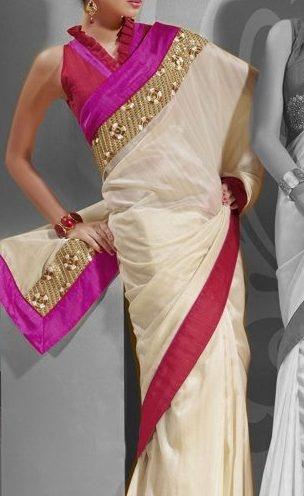 Elegant white bordered sari.
