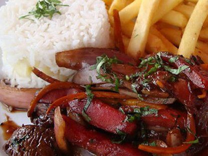 Peruvian Lomo Saltado ~ Lomo Saltado (stir-fried steak) is an extremely popular fusion dish that mixes the Chinese stir-fry tradition with Peruvian ingredients such as yellow chili pepper, cilantro and tomato. The hearty entree is always accompanied by fluffy white rice and French fries.