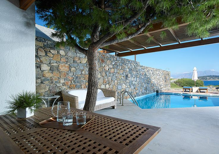 Odysseas Suite with private pool. St Nicolas Bay Resort, Agios Nikolaos Crete.      Located in a very tranquil and secluded position with your own Private Heated Pool and great Sea Views. Spacious Living Room area at the lower level with