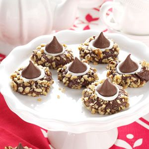 "Chocolate Thumbprints Cookies Recipe -My group of friends had a weekly ""movie night"" during winters on Martha's Vineyard, and we'd take turns making a chocolate treat to share. These terrific cookies were an instant success. Once they debuted, I had to make them many more times. —Laura Bryant German, W. Warren, Massachusetts"