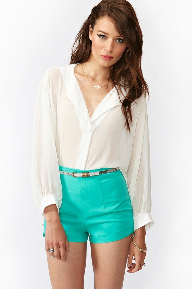 White sheer blouse with turquoise shorts