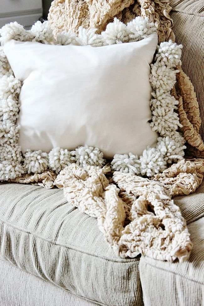 DIY Drop Cloth Pom Pom Pillow  I could stencil a starfish or seahorse design onto this