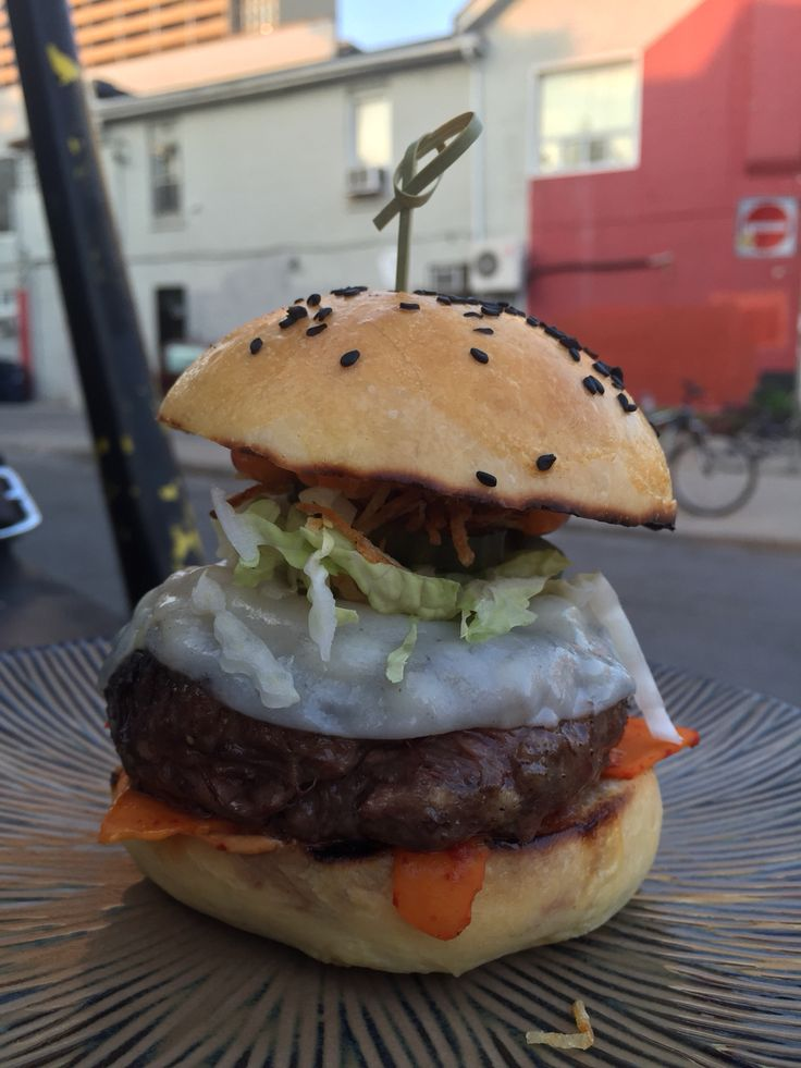 One crazy cool burger form @thefooddudesto at Rasa Bar with Kimchee butternut squash.