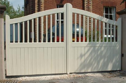 Matlock Wooden Driveway Gates Could grow climbers to soften it and give more privacy