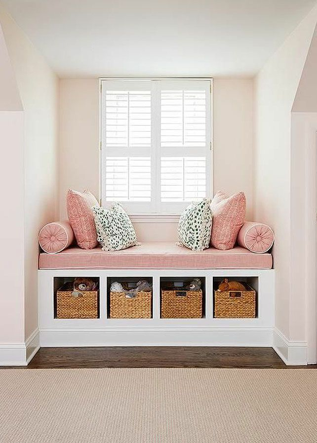 built-in reading nook with woven storage baskets in cubbies. / sfgirlbybay
