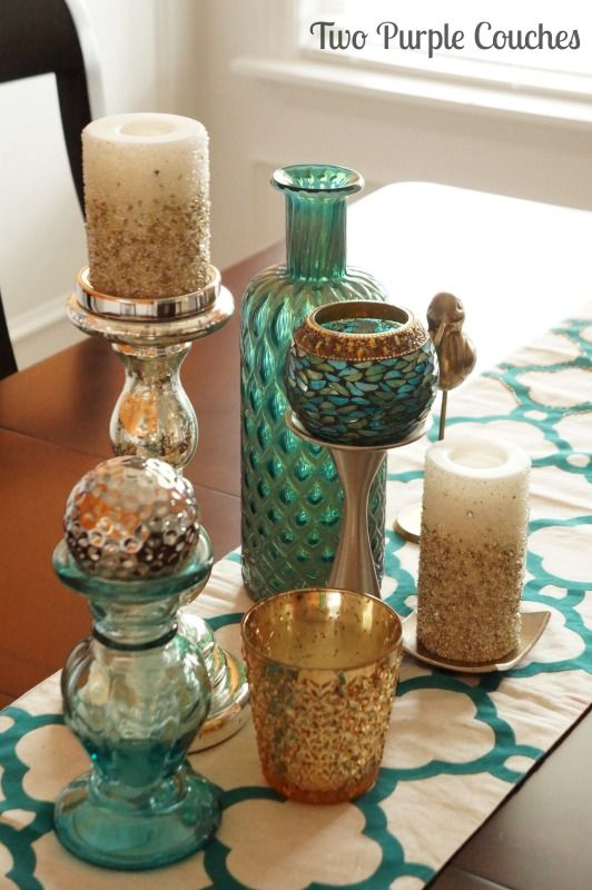 Beautiful orange & teal dining room decor. via www.twopurplecouches.com
