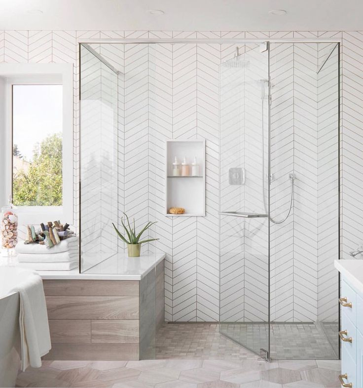 Walk In Shower With Floor To Ceiling White Herringbone Tile Glass Shower Doors Spa Like Bathroom Design Ba Home Bathroom Interior Design Bathrooms Remodel