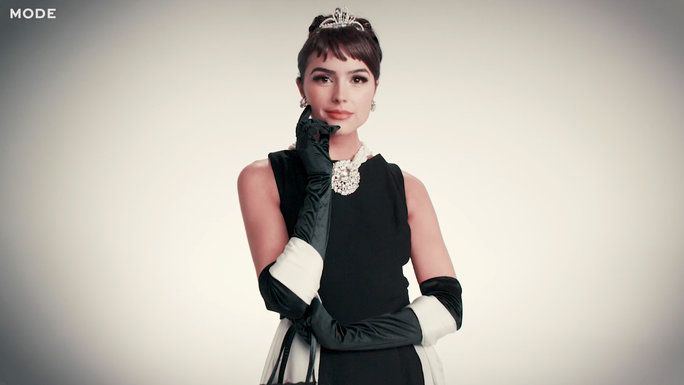 Watch Olivia Culpo dress up as an iconic female movie character from each decade since the 1910s.