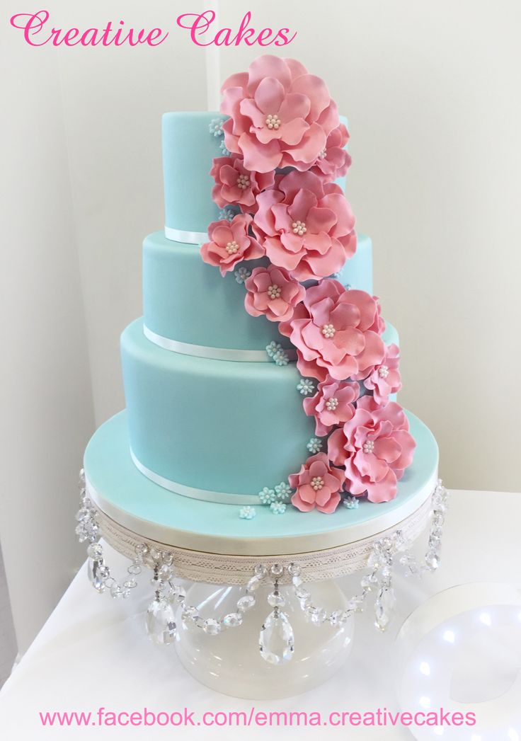 Wedding cake in duck egg blue with pink corsage cascading flowers - design chosen by bride and made by Creative Cakes