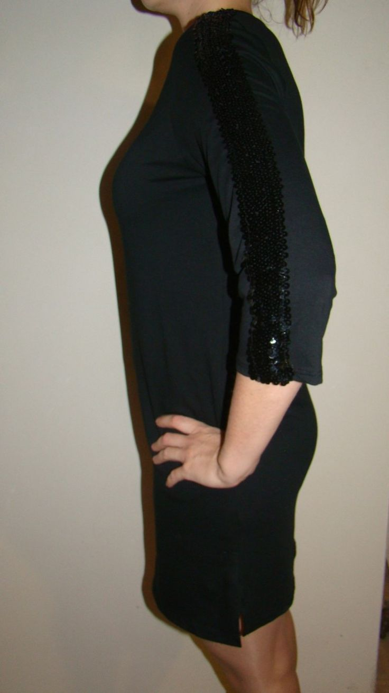 zwarte jurk met zwarte pailletten  http://retroboutique.be/vintage-kleding/black-dress-met-zware-pailletten.html