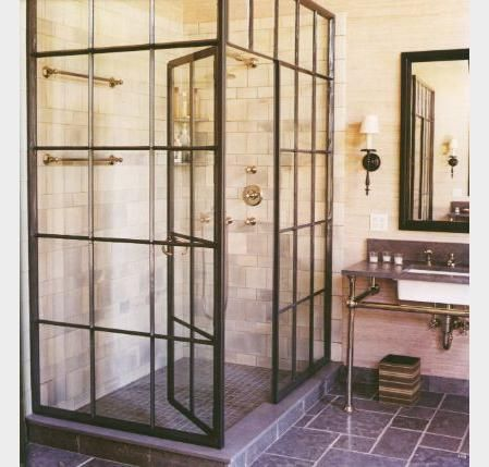 riff on casement windows for shower enclosure. installation by Remains Lighting, bathroom by Jeffrey Bilhuber