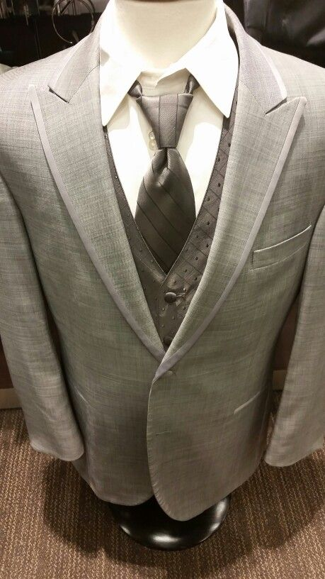 Men's Wearhouse tuxedo; groomsmen and ushers will wear this grey vest and tie with ivory shirt, groom wears ivory tie and vest, dads wear black ties and vests