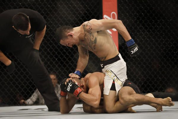 DETROIT (AP) -- Max Holloway defended his UFC featherweight title by beating Jose Aldo in a rematch, winning his 12th straight fight with a TKO late in the third round Saturday night. Holloway (19-3) beat Aldo in his native Brazil in June, rallying from a slow start to win with a TKO in the third.   #Brazil #Conor McGregor #Detroit #Frankie Edgar #Hawaiian #Jose Aldo #Max Holloway #technical knockout #TKO #UFC #UFC Featherweight Championship #Ultimate Fighting Championship