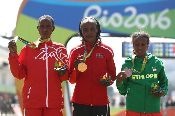 Silver medalist Eunice Jepkirui Kirwa of Bahrain, gold medalist Jemima Jelagat Sumgong of Kenya and bronze medalist Mare Dibaba of Ethiopia pose during the medal ceremony for the Women's Marathon on Day 9 of the Rio 2016 Olympic Games at the Sambodromo on August 14, 2016 in Rio de Janeiro, Brazil.