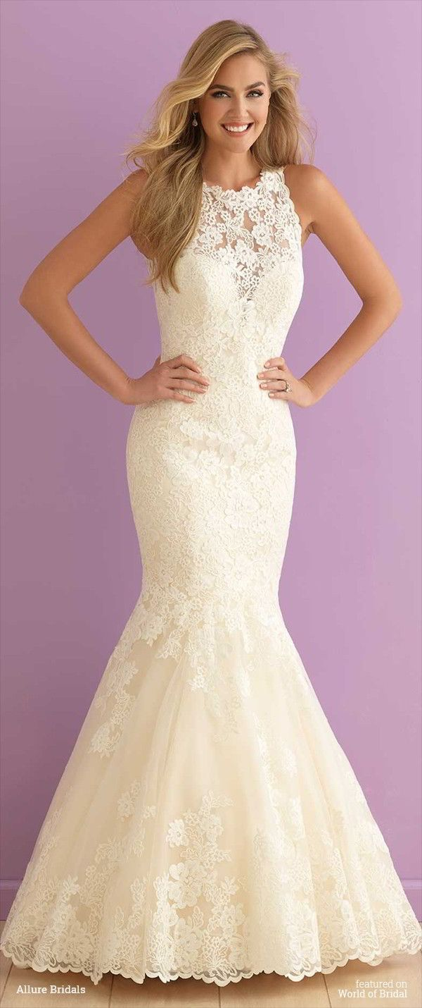Mermaid Wedding Dresses Liverpool : Ivory lace blossoms cover the high neckline and illusion back of this