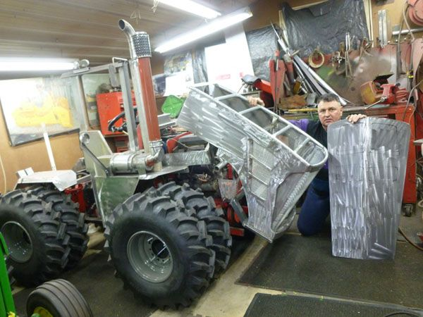 Me doing sheet metal work on the hood Custom Built mini tractors
