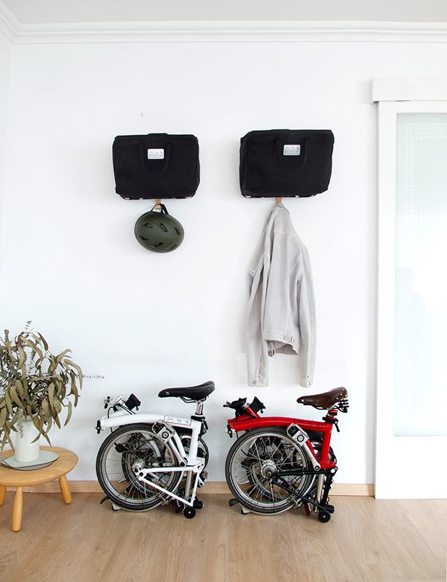 BromHome is a wall hanger designed to fit your Brompton bag.  www.amordemadre.com