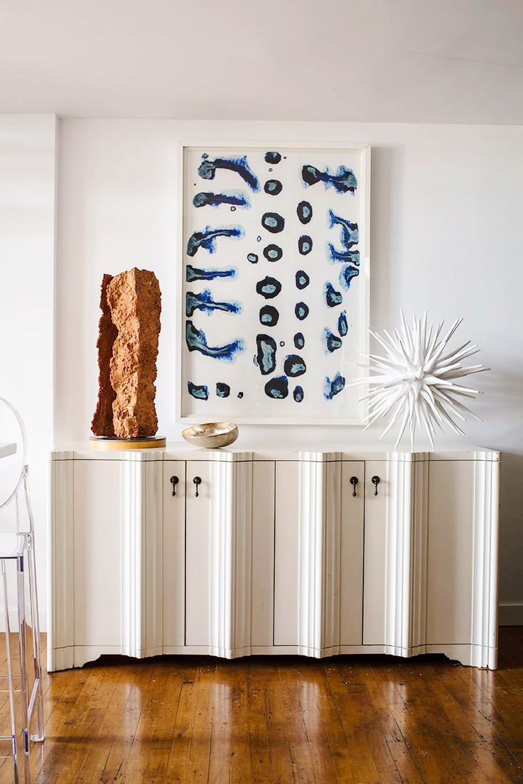 There is a dressing table mirror and lockers and drawersgalore - Buffet Table In Home With Modern Art And Sculptures Styled