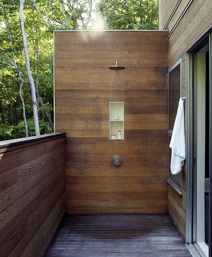 modern outdoor showers - Wood planked outdoor shower with pressure balance valve and built in niche adjacent to a bedroom - Dwell via Atticmag