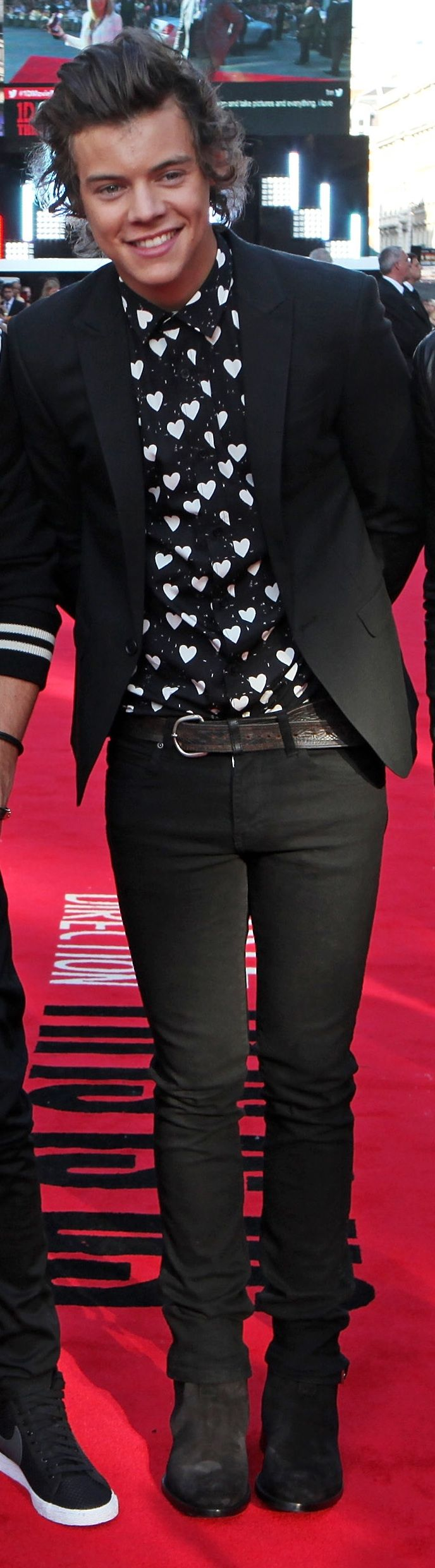 British musician Harry Styles wearing Burberry to attend the premiere of One Direction: This Is Us in London