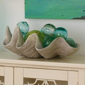 I have a new obsession! I love these giant clam shells. The real ones are over $1200!!! Plus the harvesting of them has caused a real decline in the population of the clams. However, they make resin ones for around $50.00. I may have to find one or two...I will be pinning more ideas using them:-)