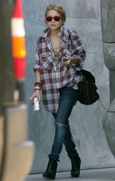 I have seen several fashion pics where one side of the shirt tail is sucked in and the other hanging out. Cute! Mary-Kate Olsen's street style