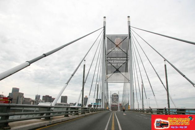 Drive over the Nelson Mandela Bridge in Johannesburg. Get there by hopping on our Joburg Red Bus. http://www.citysightseeing.co.za/joburg.php