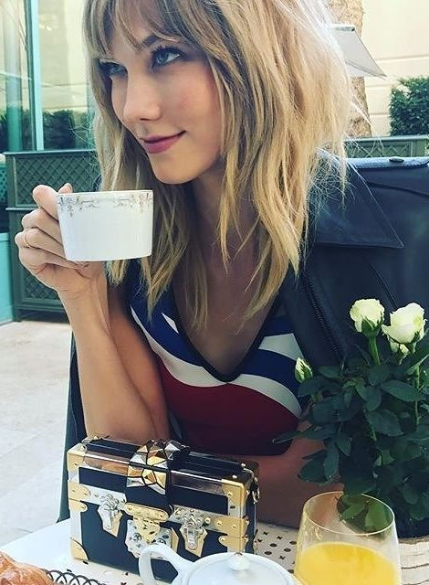 Karlie Kloss debuts shaggy layers and tapered bangs in Paris.