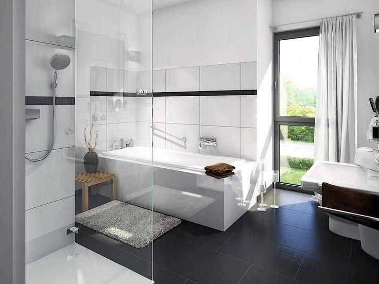 Badezimmer modern mit Badewanne & Fliesen weiss/ schwarz – Ideen Inneneinrichtung Fertighaus Stadtvilla EVOLUTION 122 V10 von Bien Zenker – HausbauDir…