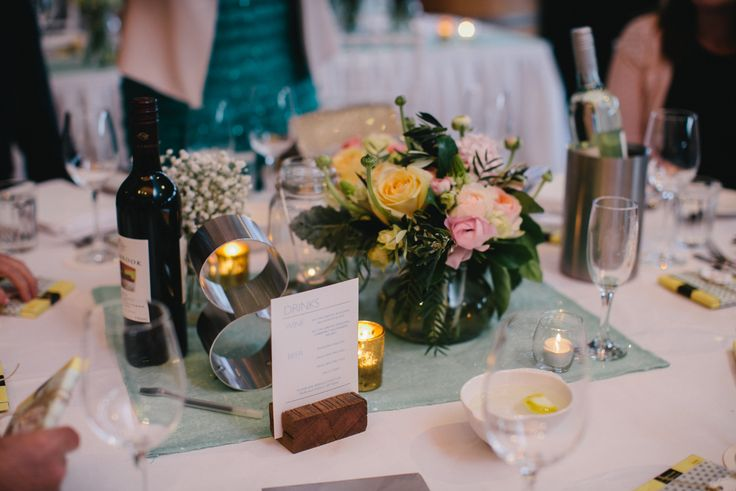 Mint Green & Pastel Floral centrepiece. Metal Table Numbers.