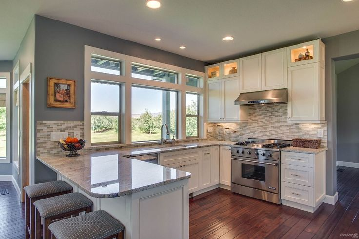 Transitional Kitchen with Flat panel cabinets, Flush, Undermount sink, Hardwood floors, Breakfast bar, Ceramic Tile, U-shaped