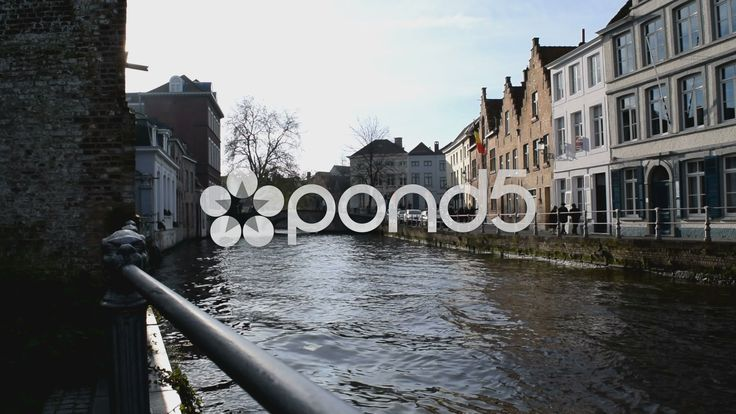 Rough water on a canal in Bruges, Belgium after a boat has passed. - Stock Footage | by glenman77