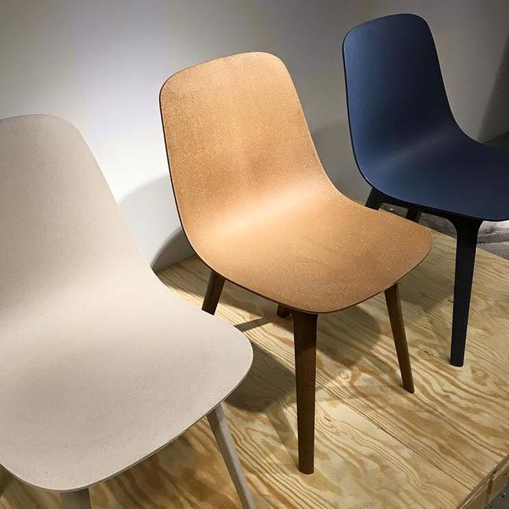 Stockholm studio Form Us With Love, which previously created a pair of moulded plastic chairs for IKEA, has designed another seat for the brand.This chair, called Odger, has a rounded shell moulded from 70 per cent recycled plastic and 30 per cent renewable wood. It will be available from 2017 in white, blue and brown, with wood flakes visible across the surface.