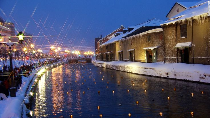 Hundreds of buoyed candles float in Otaru Canal every February in Otaru Japan, during the Snow Light Path Festival