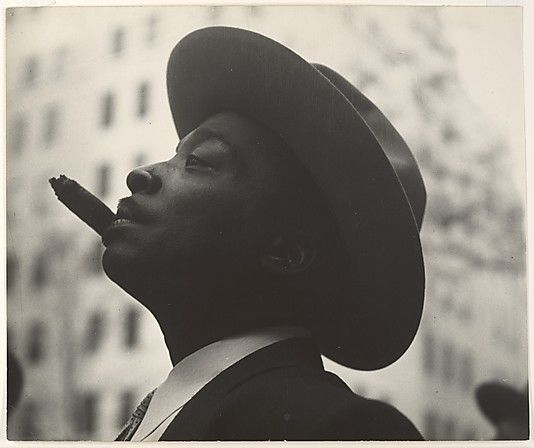 Wearing a hat is all about attitude. Ca. 1960. Head of Man with Hat and Cigar. Picture by Leon Levinstein.