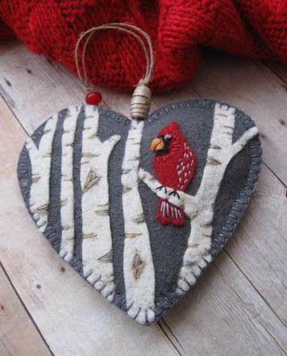 """Cardinal in Birch Ornament BY SandhraLee @Etsy: I made the ornament from gorgeous 100% wool felt, using a slate grey for the background, ecru for the birch trees & a lovely rich red for the cardinal. The trees & bird are needle-felted & embroidered onto the background & the ornament is plumped out w/ polyester craft batting. The cardinal's eye is a tiny blue glass seed bead. Measures approximately 4 1/4"""" in both H & W, & features a hemp twine loop for hanging. $18.00."""