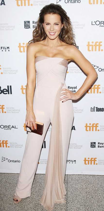 KATE BECKINSALE Beckinsale stood out in a dramatic Azzaro Couture jumpsuit paired with nude Brian Atwood sandals and a Lee Savage clutch at the premiere of The Face of an Angel.