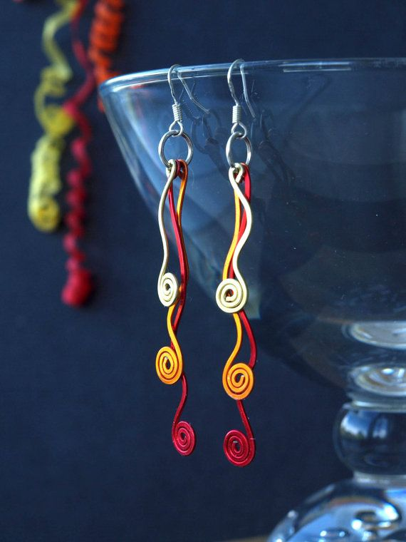 Party Popper aluminum earringsby HandmadeEarringsUk on Etsy. Available in different colour combinations.