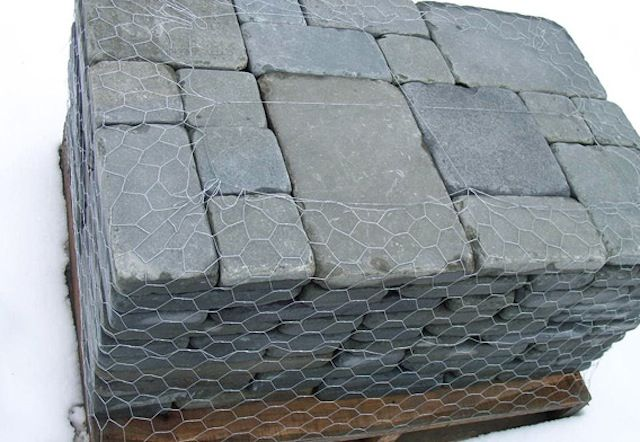 Tumbled Bluestone Pavers is what I really want to use to cover the old concrete patio, sidewalk and driveway.