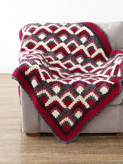 Squares don't have to be boring with this afghan. (Lion Brand Yarn)