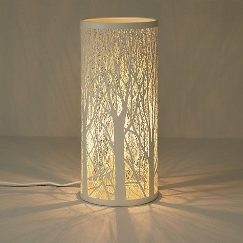 When lit, the light escapes through the gaps and casts the forest against the walls. | John Lewis Devon Table Lamp, White | £35
