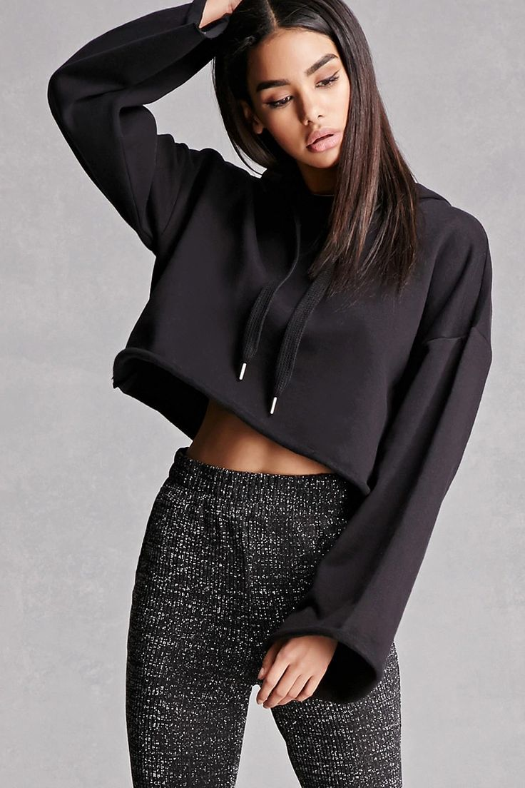 A pair of shimmering glitter knit pants featuring a tapered leg, smocked high waist, and elasticized cuffs. This is an independent brand and not a Forever 21 branded item.