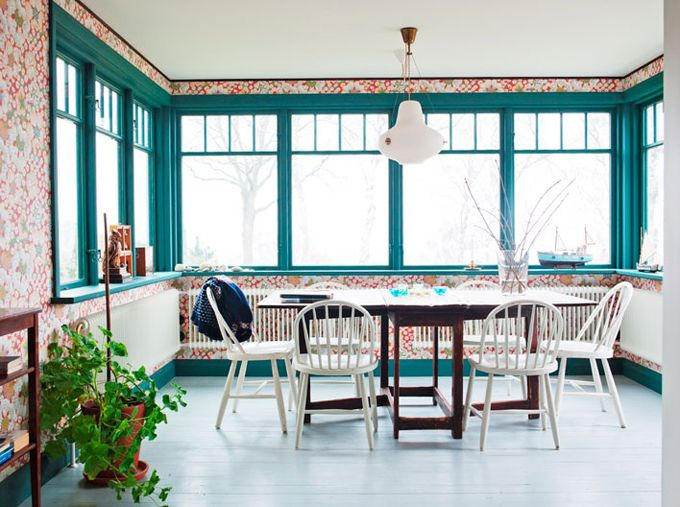 Located in Sweden, the 4-story home overlooking the sea was built in 1916, but the owner André Waldhör spent three years renovating the space.