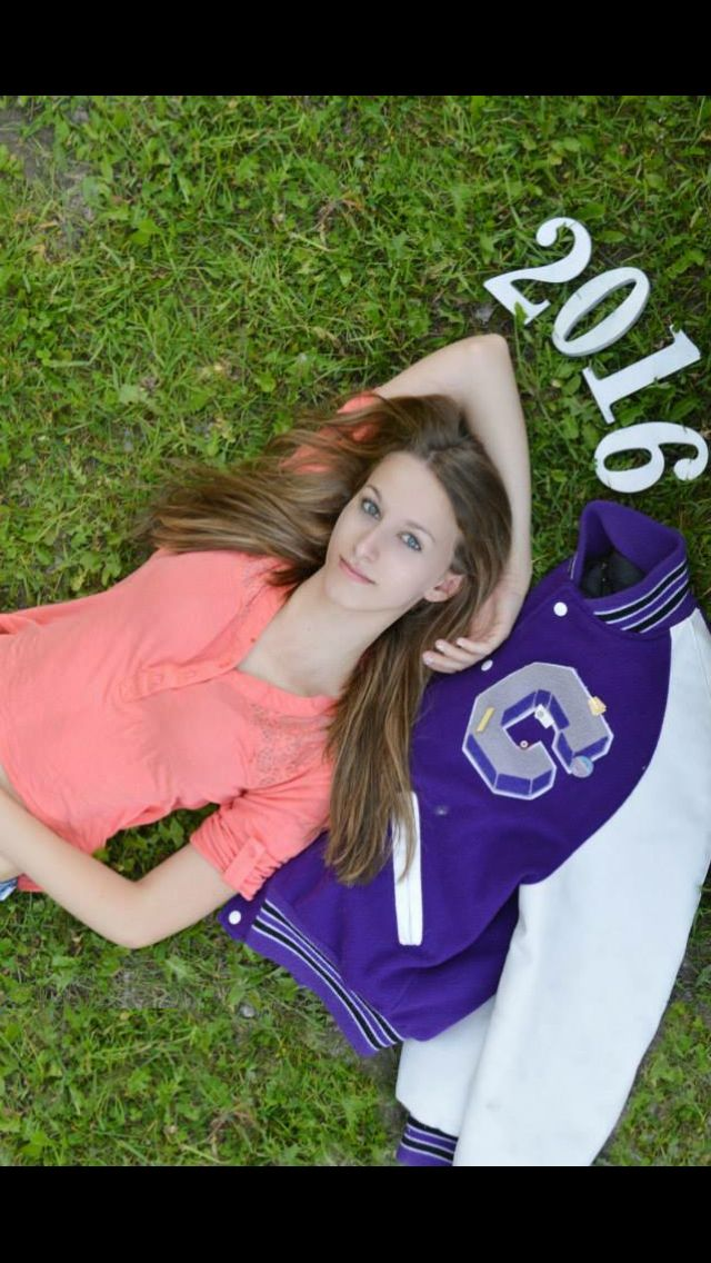 Senior picture ideas for girls. Letterman's jacket pose.