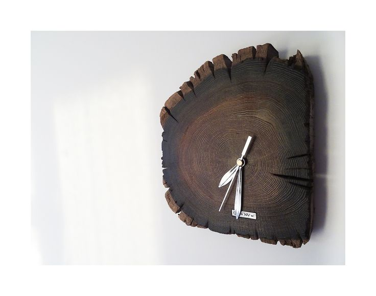 Model no 15. This clock is made of construction wood from the buildings of the Old Town of Gdansk. Black oak dating back to the 14th century. Size 25 cm x 24 cm.