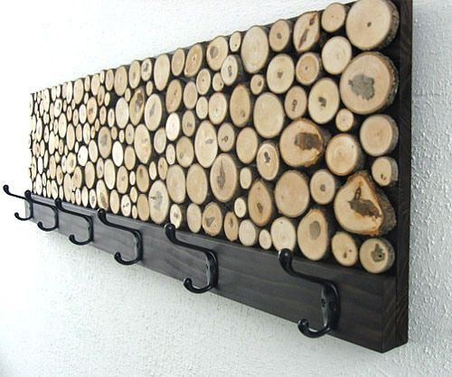 sliced wood DIY coat rack.. love this cute piece.. I could see using a old cabinet door as the base of this project to further the reuse and upcyle feature.