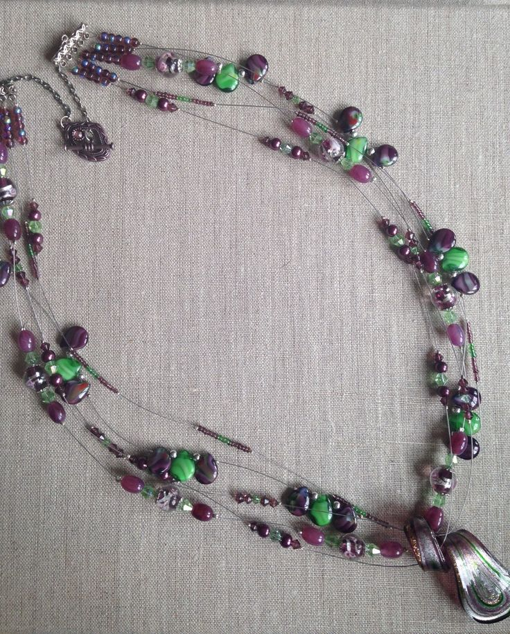 A personal favorite from my Etsy shop https://www.etsy.com/listing/250802228/purple-green-multi-strand-necklace-with