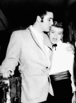 "Elvis Presley with Alis Lesley, ""The Female Presley"", at the Silver Slipper Casino in Las Vegas, Nevada, November 13, 1956."