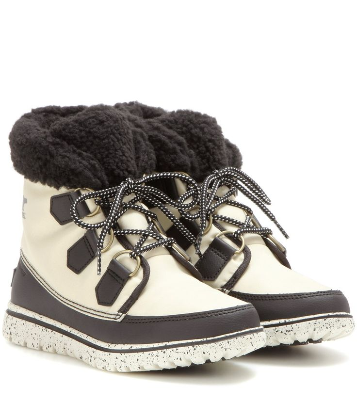 Sorel - Cozy™ Carnival fleece lined ankle boots - Cosy and chic: have the best of both worlds with Sorel's sneaker-style ankle boots. The waterproof design is trimmed with smooth black leather and lined with warm, black fleece. A gripping rubber sole ensures traction on wet days. seen @ www.mytheresa.com